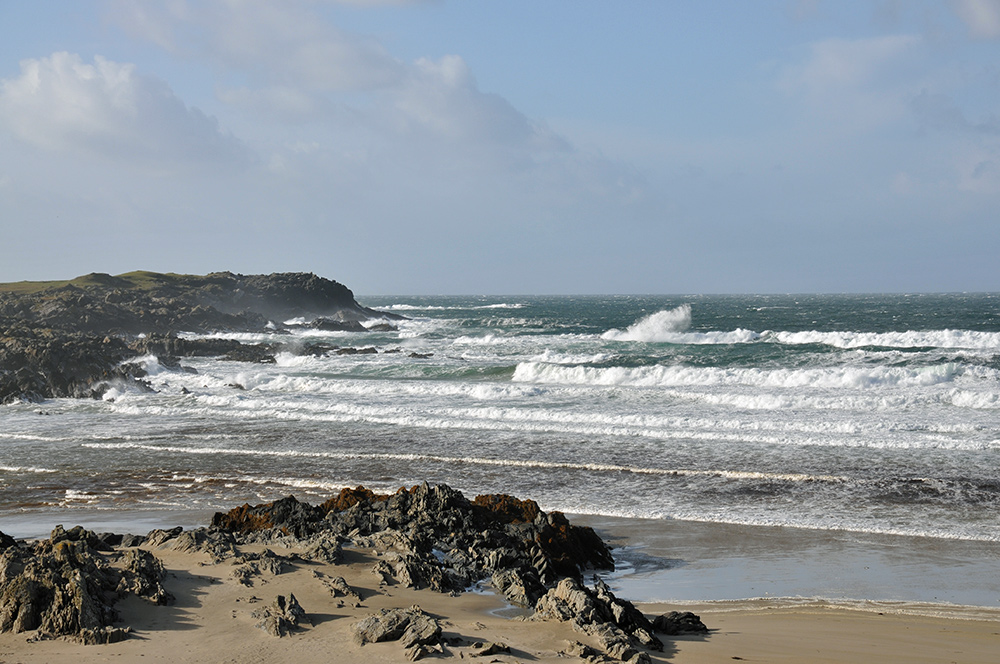 Picture of a bay with a beach on a windy October day, waves rolling in