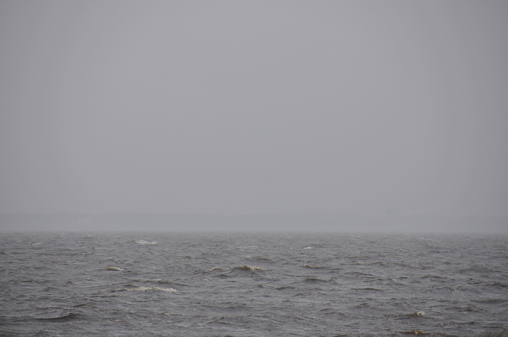 Picture of a sea loch on a grey misty and cloudy day