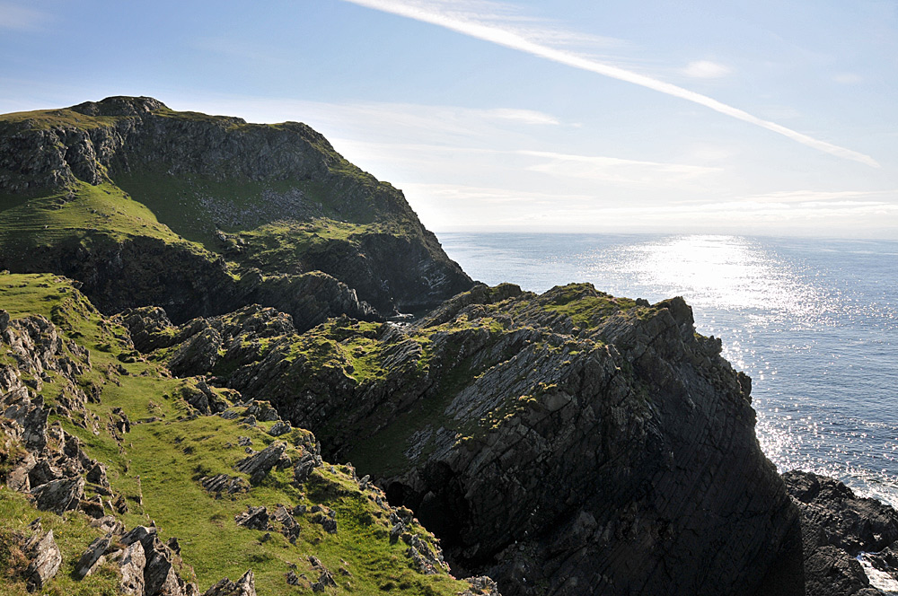 Picture of large rugged cliffs on a bright sunny day