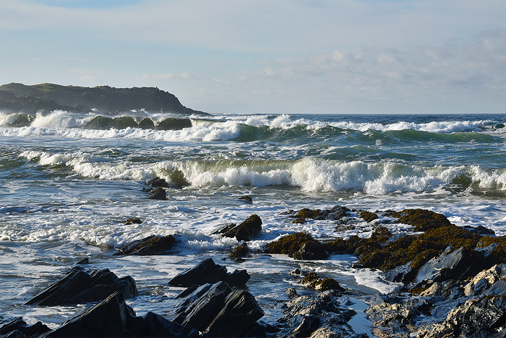 Picture of waves breaking in a bay on a sunny November day