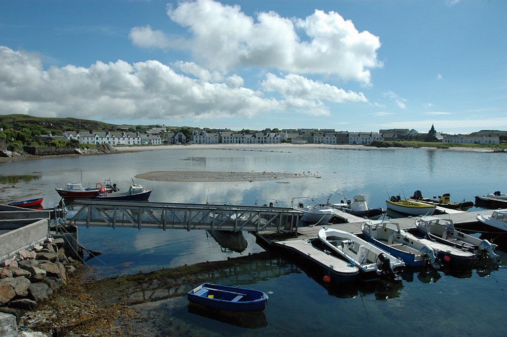 Picture of a coastal village at a small bay, a small pier in the foreground