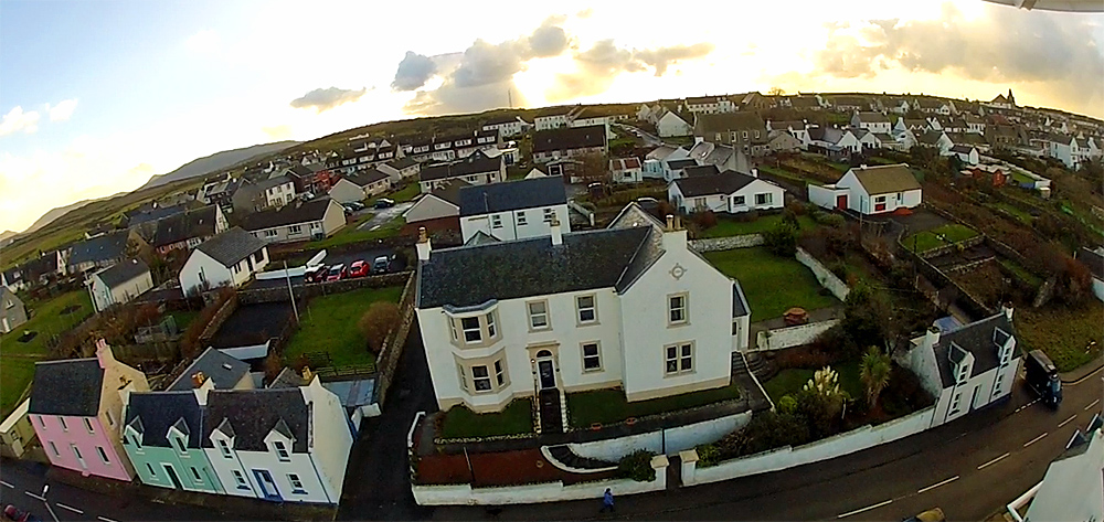 Picture of a guesthouse in a village taken from a quadcopter