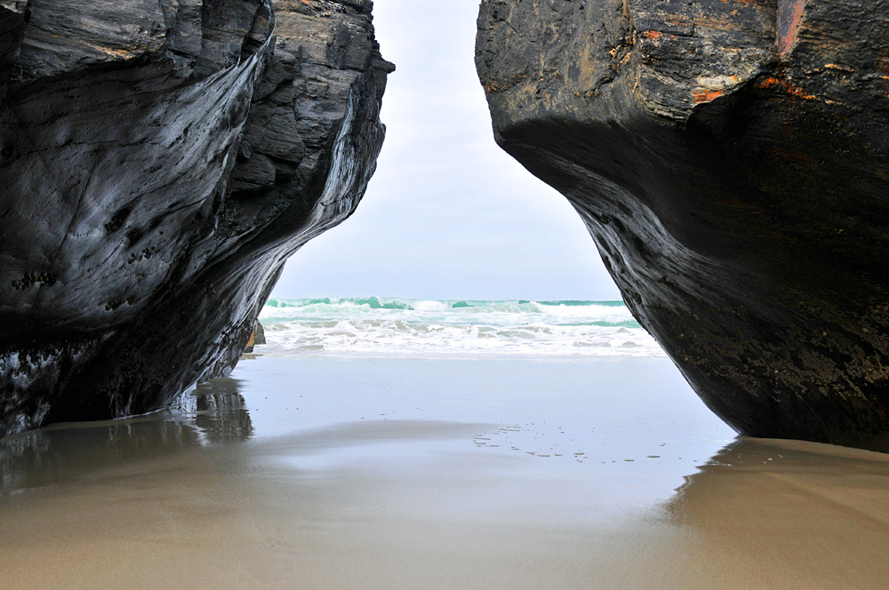 Picture of what I believe to be a collapsed natural arch on a coast