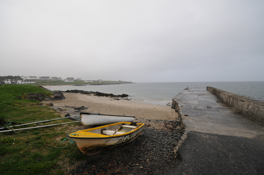 Picture of a view from a pier at a sea loch on a grey and cloudy (dreich) evening