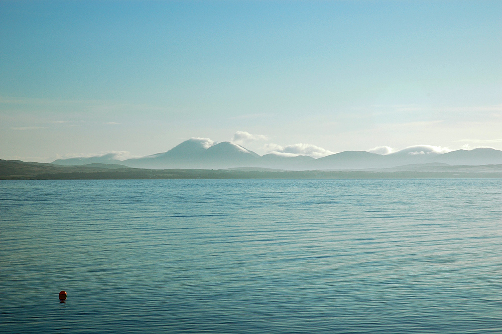 Picture of a mountain range seen across a sea loch