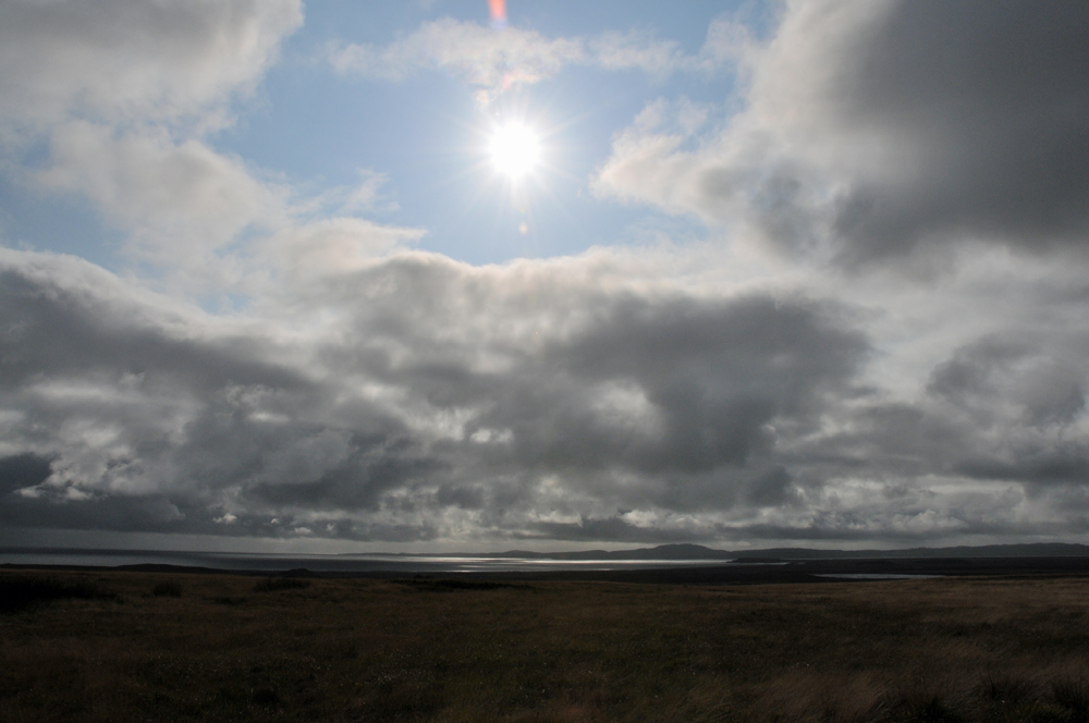 Picture of a break in the clouds over a wide coastal landscape
