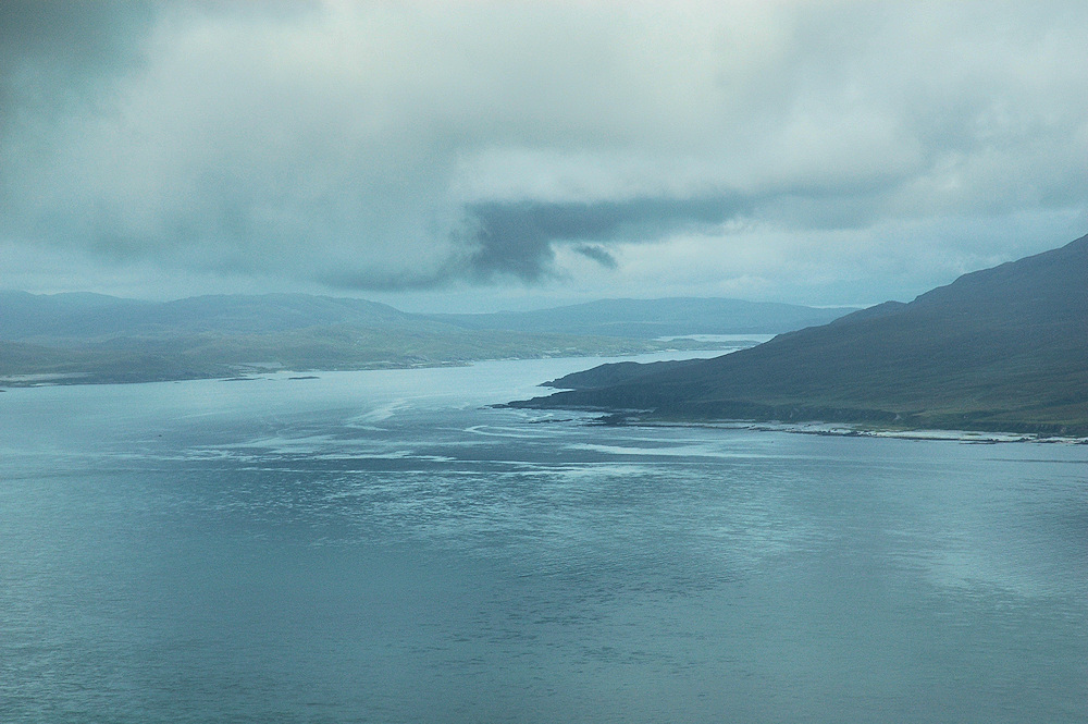 Picture of a view across a sound to the entrance of a sea loch