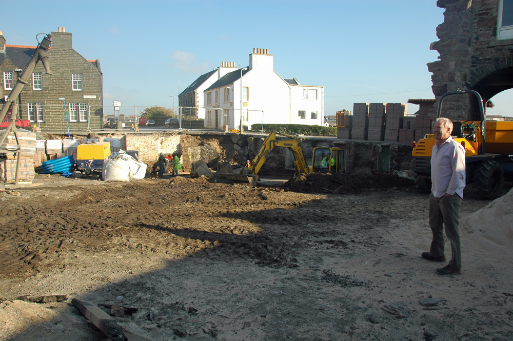 Picture of a construction site with the foundations being prepared