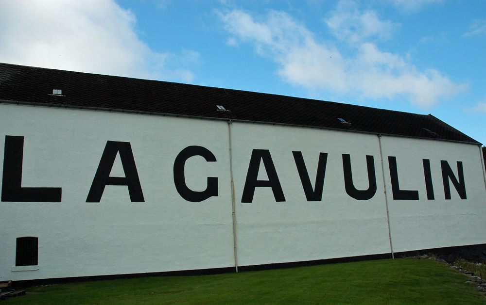 Picture of a warehouse wall with Lagavulin written on it in large letters