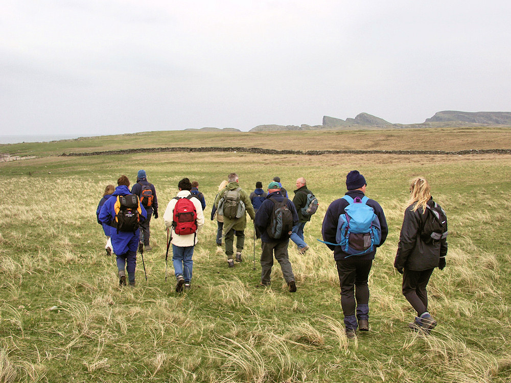 Picture of a group of walkers in a coastal landscape