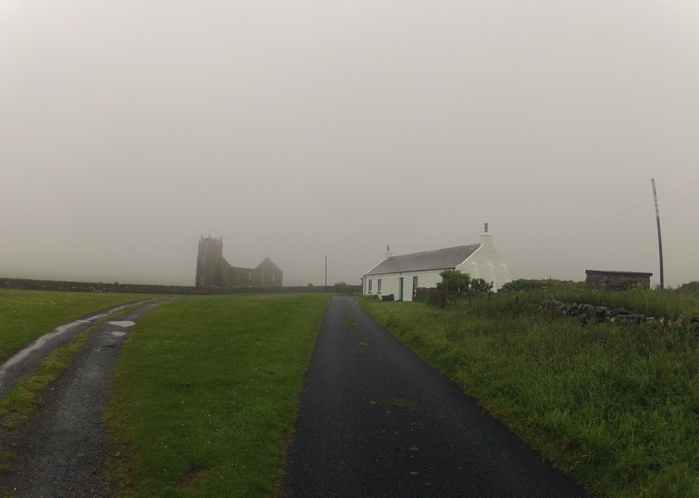 Picture of a church and a cottage on a rainy day