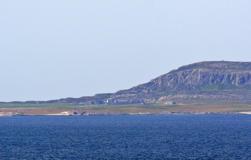 Picture of a view across the sea to a priory on a small island