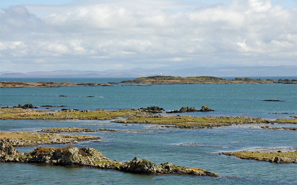 Picture of a view over skerries on the coast of an island