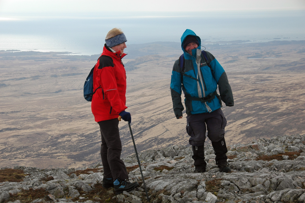 Picture of two walkers on top of a hill on a windy day