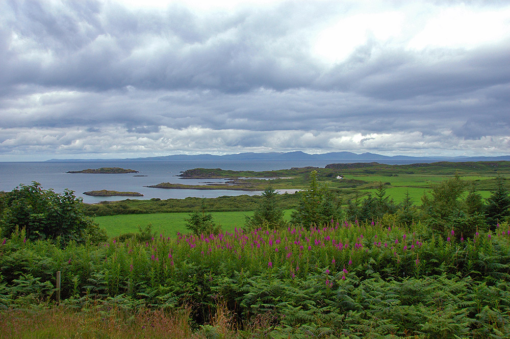Picture of a view over a coastline and over to another island from a viewpoint