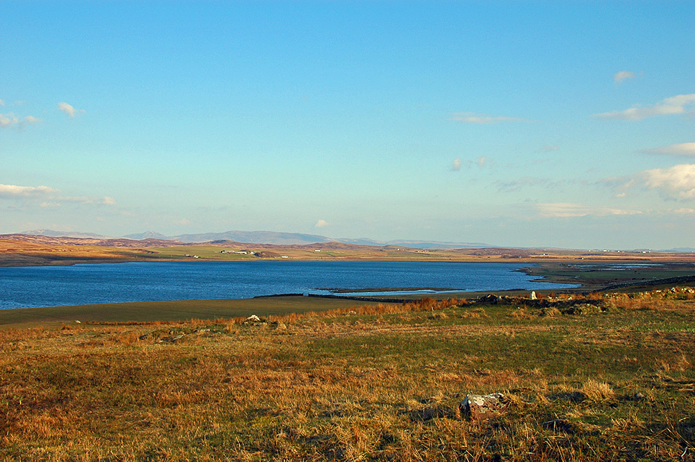 Picture of the top of a sea loch on a sunny April evening
