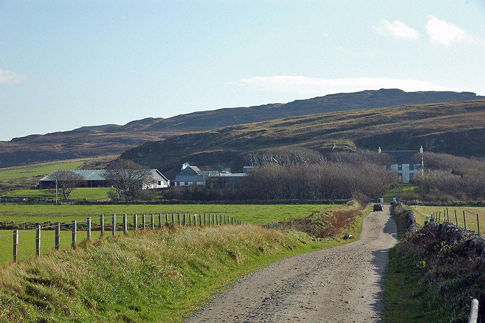 Picture of a farm with a farm distillery, taken from the track to the farm