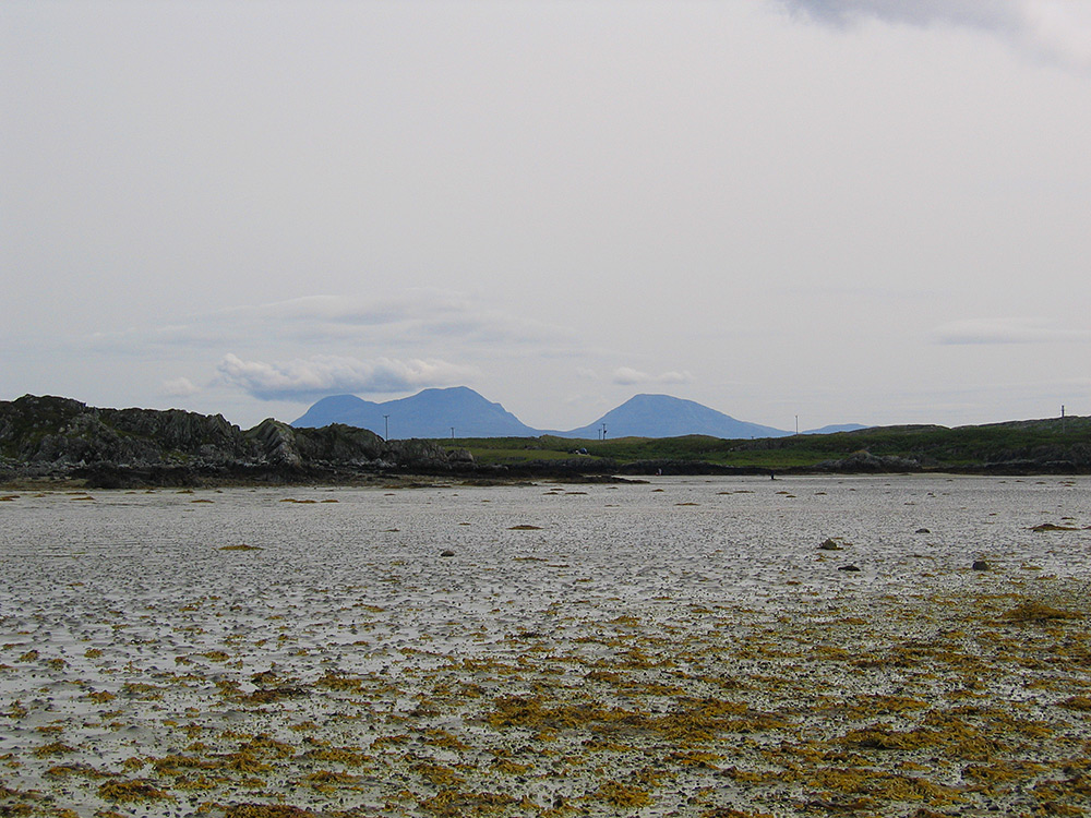 Picture of a view from a beach between two islands fallen dry at low tide