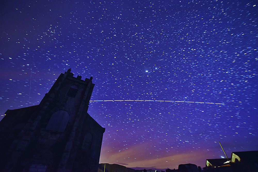 Picture of a space station pass in the night sky