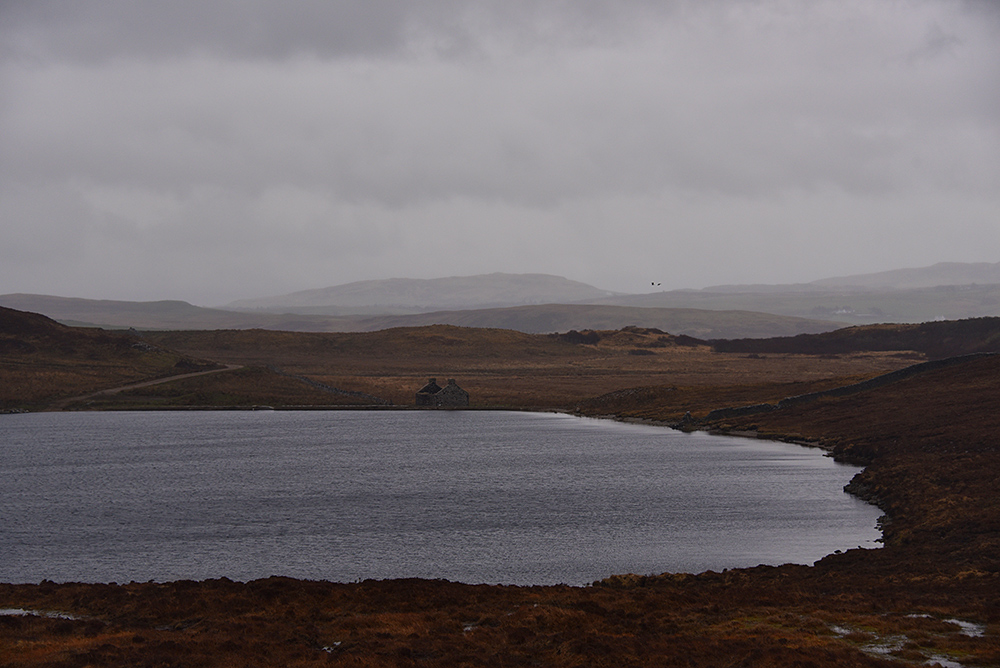 Picture of a view over a loch (lake) on a dreich, grey, gloomy day