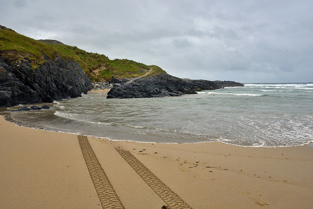 Picture of a track over a beach cut off during high tide