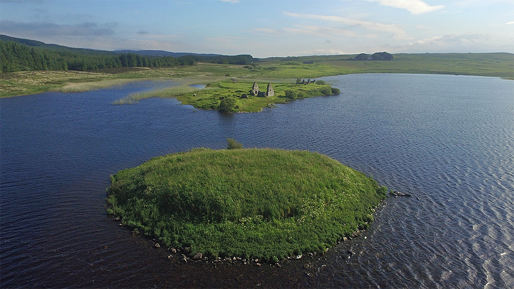Picture of two small islands in a freshwater loch, ruins on one of them
