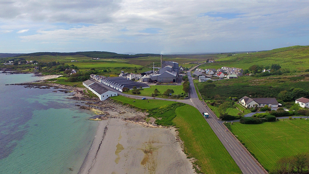 Picture of distillery warehouses and a modern maltings on a coast seen from  the air