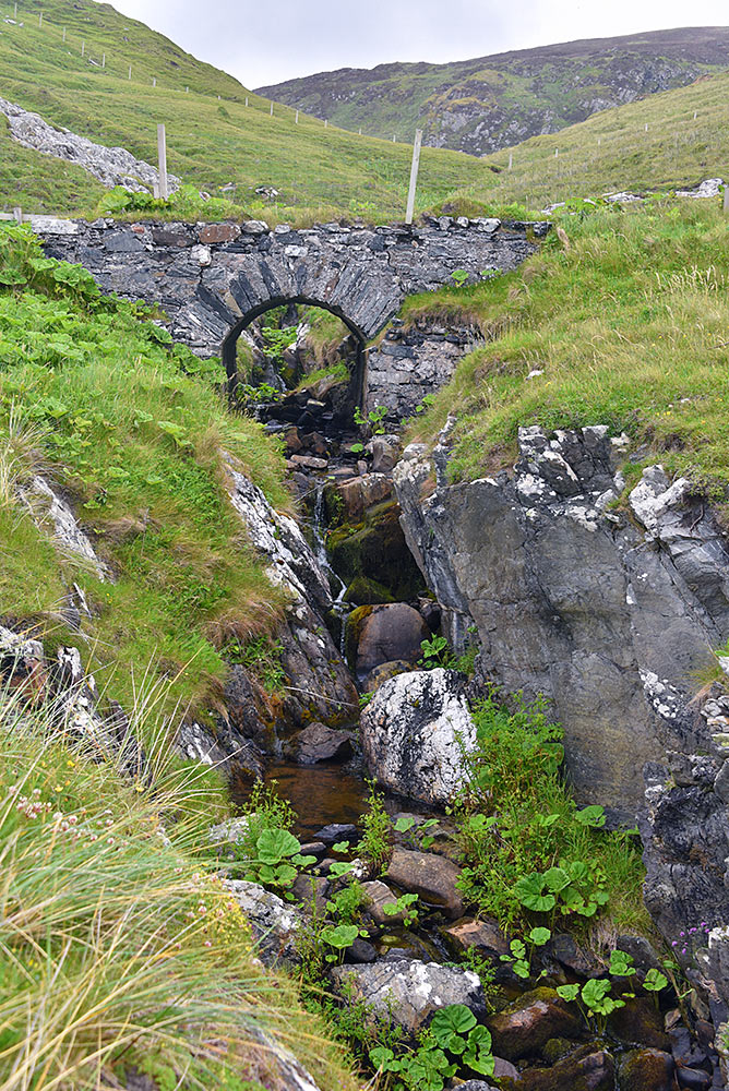 Picture of an old stone bridge over a small burn (stream)
