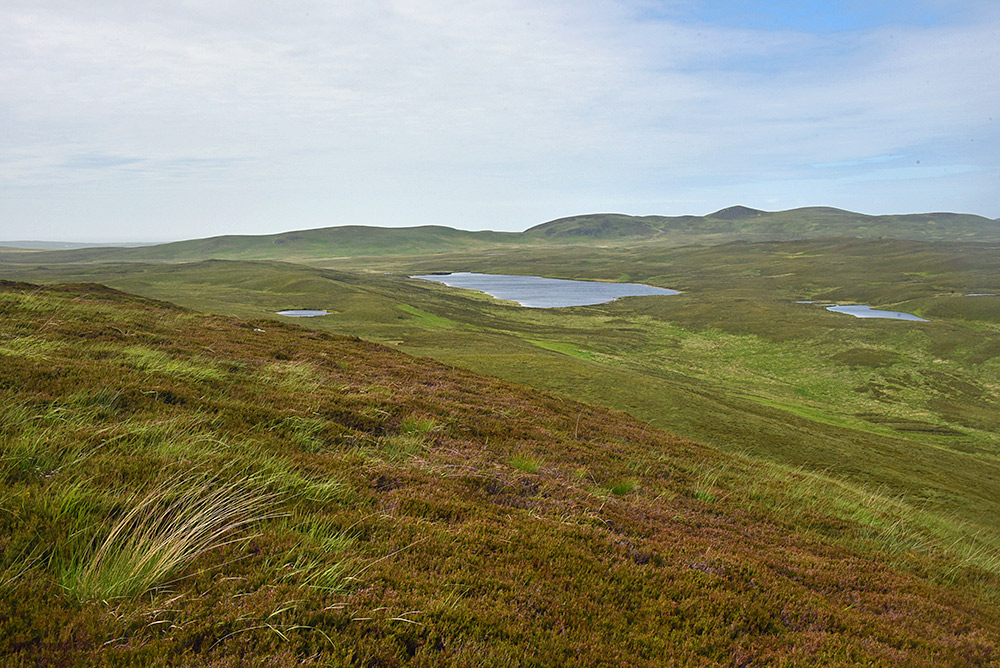 Picture of a glen (valley) with a larger loch (lake) and a few smaller ones
