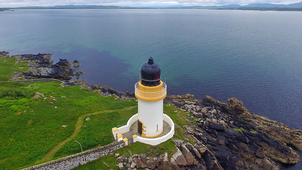 Picture of a small lighthouse seen from the air