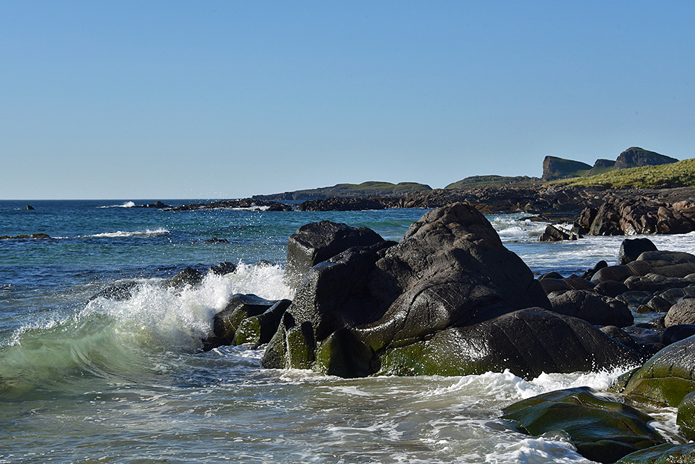 Picture of a rocky shoreline with small waves breaking