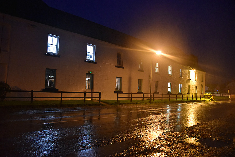 Picture of Bruichladdich distillery on a dark rainy evening