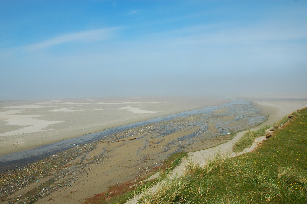 Picture of a beach with low coastal fog (haar) rolling in