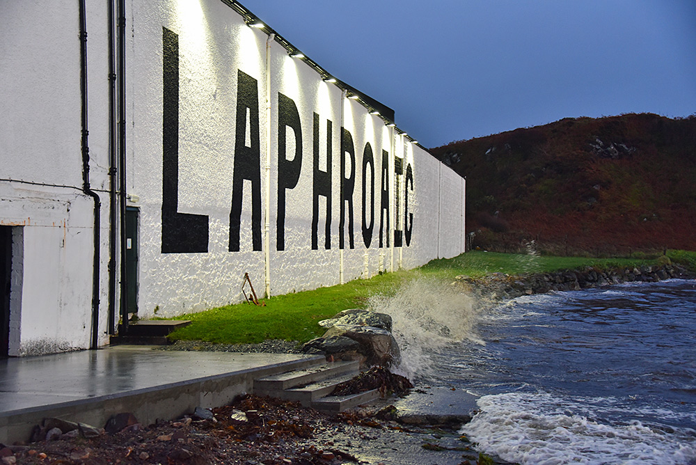 Picture of a small wave breaking on a sea wall outside of Laphroaig distillery