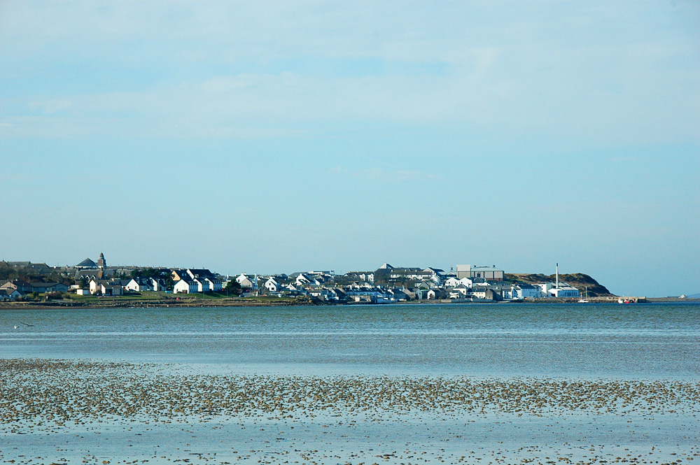 Picture of a coastal village seen from the sea at low tide