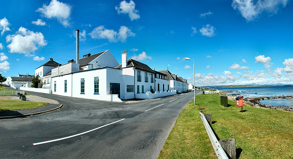 Panoramic picture of Bruichladdich distillery on the shore of a sea loch