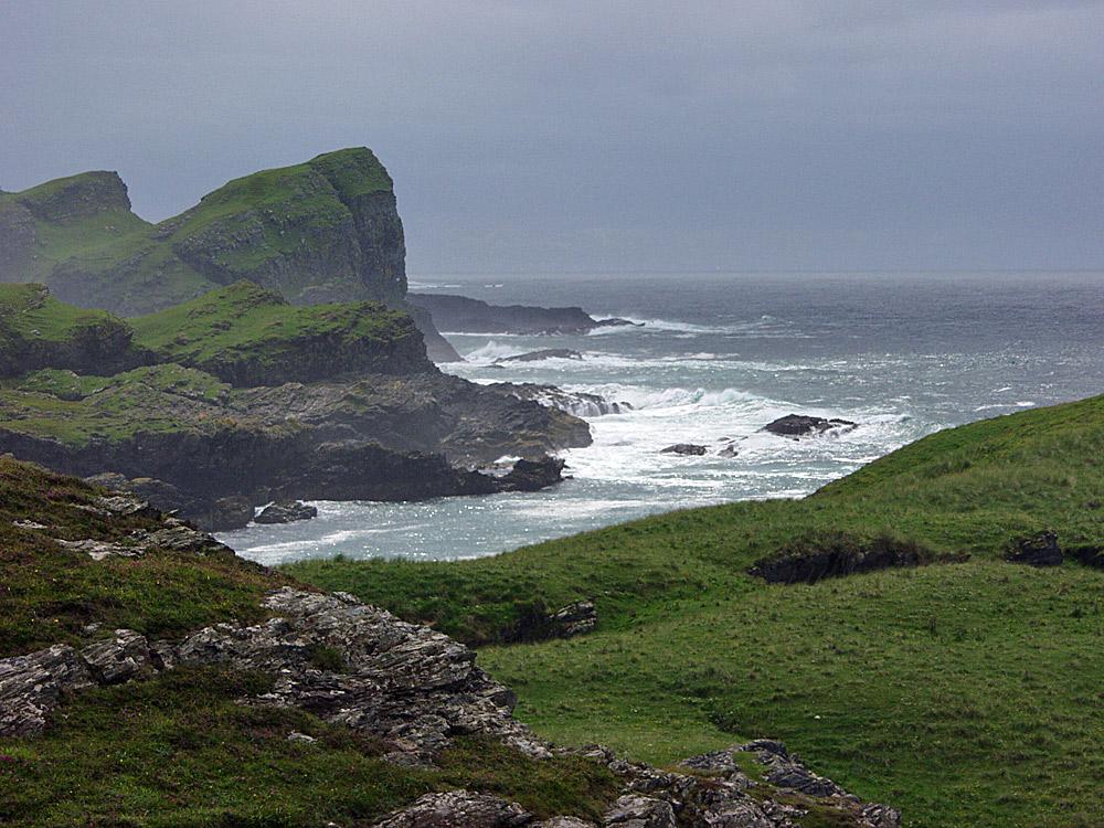 Picture of steep cliffs under dark clouds