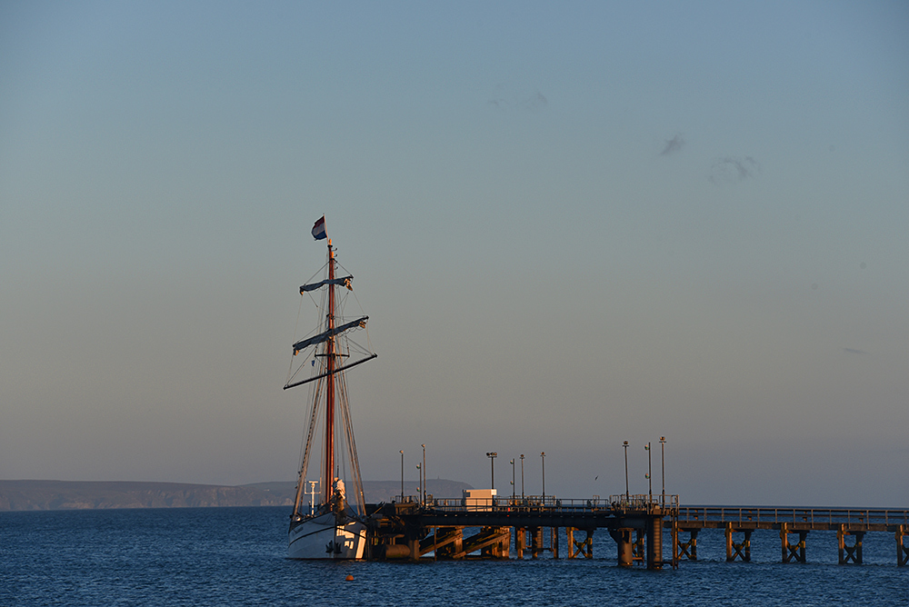 Picture of a tall ship moored at a pier