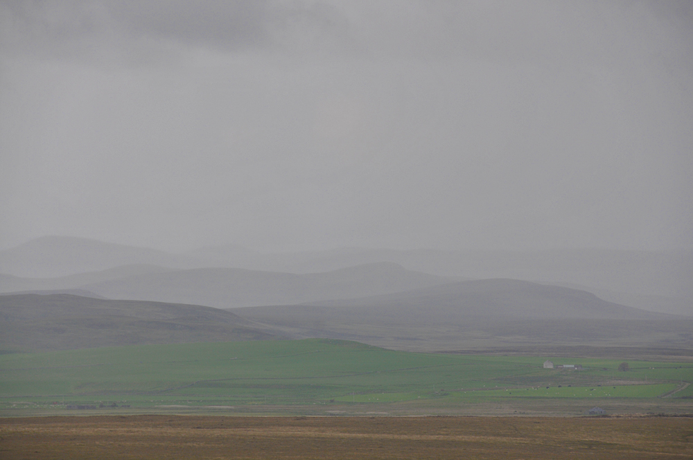 Picture of a hilly landscape in the rain