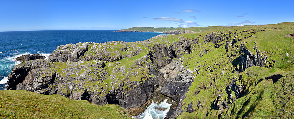 Panoramic picture of rugged cliffs on a sunny day