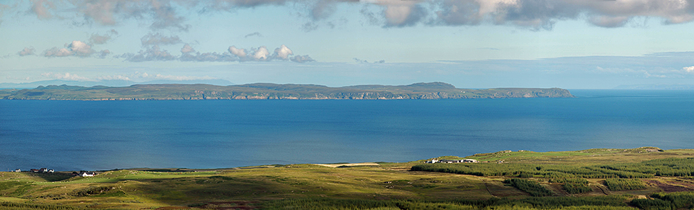 Picture of a peninsula seen across a sea loch from a hill