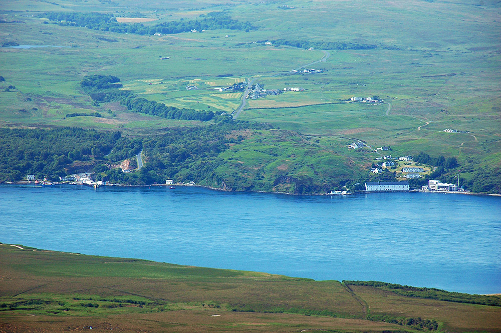 Picture of two settlements at a sound between two islands, seen from a mountain