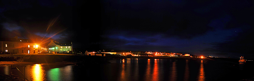 Panoramic picture of a coastal village at night
