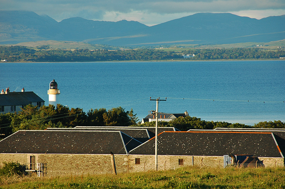 Port Charlotte warehouses and Loch Indaal lighthouse, Isle of Islay