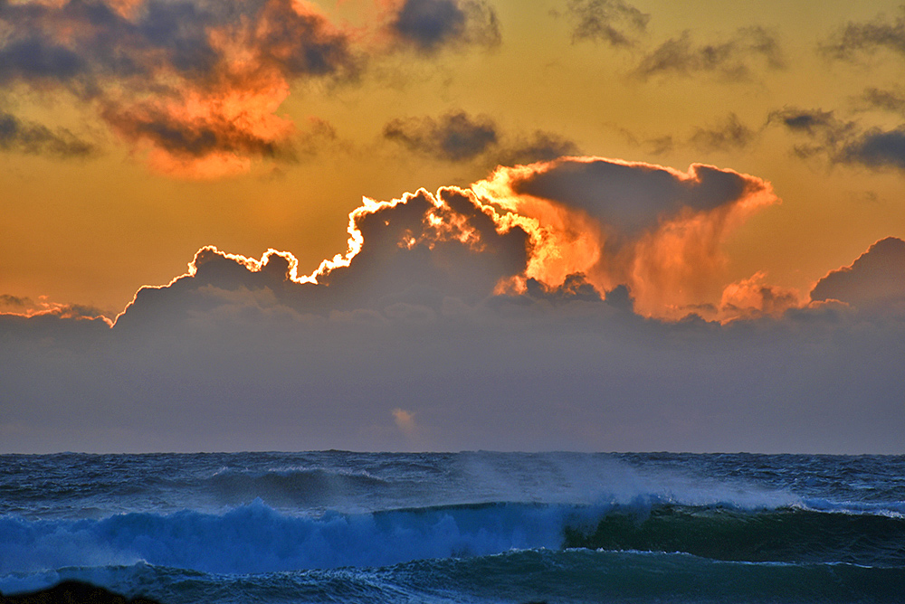 Picture of dramatic clouds over the sea during a sunset