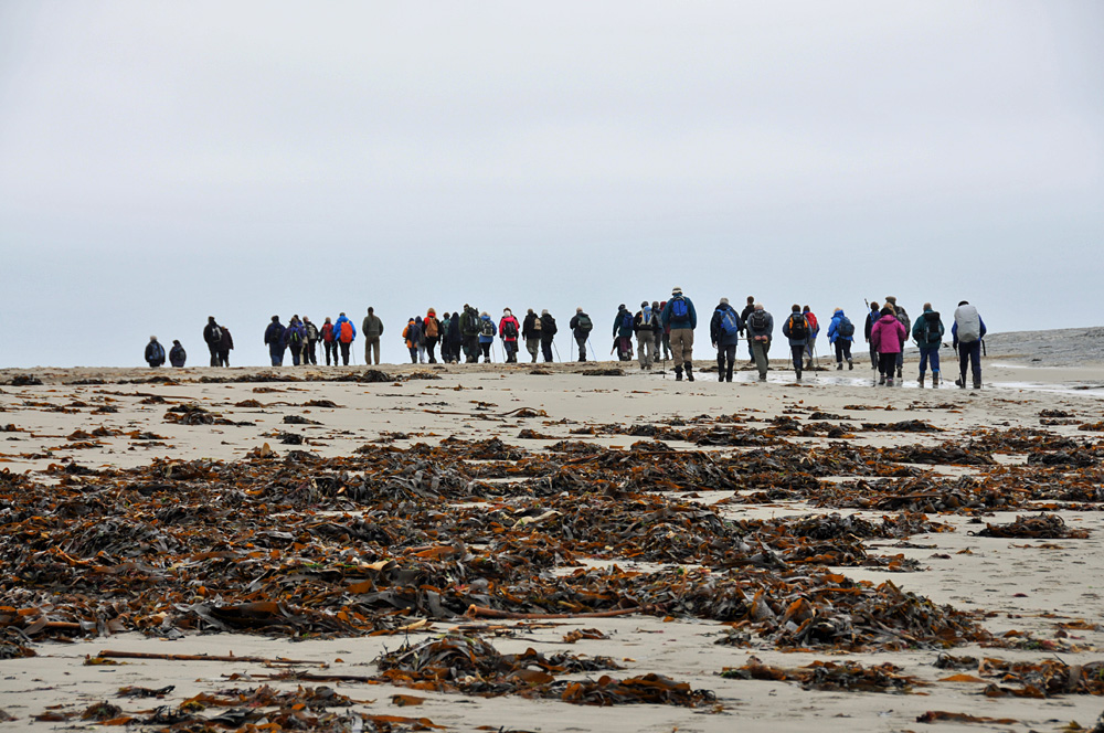 Walkers on the beach at Ardnave, Isle of Islay