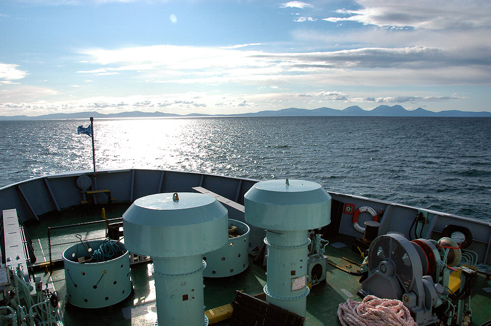 Picture of a view from a ferry towards two islands