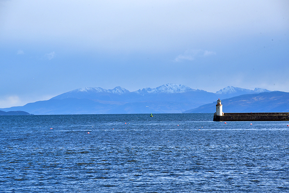 Snowcapped Arran and Ardrishaig lighthouse (journey to Islay)