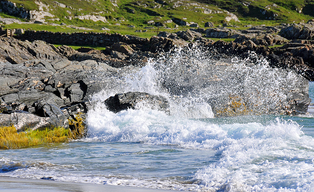 Picture of a wave breaking over rocks