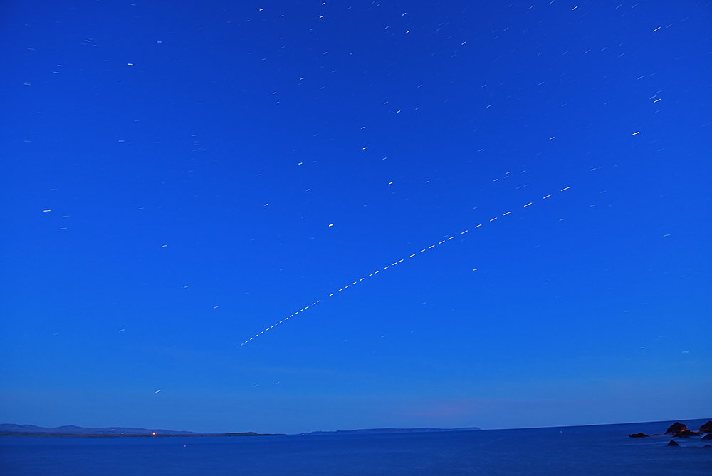 Picture of the trail of the International Space Station (ISS) passing over a sea loch